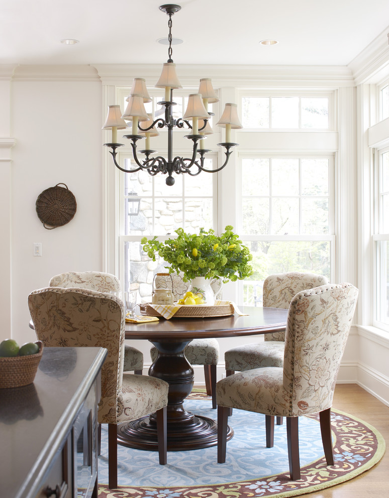 Inspiration for a large timeless medium tone wood floor and brown floor kitchen/dining room combo remodel in Boston with white walls