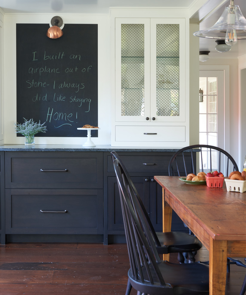 Large country dark wood floor and brown floor kitchen/dining room combo photo in New York with white walls