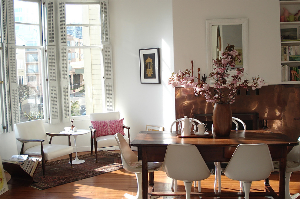Example of an eclectic medium tone wood floor dining room design in San Francisco with white walls