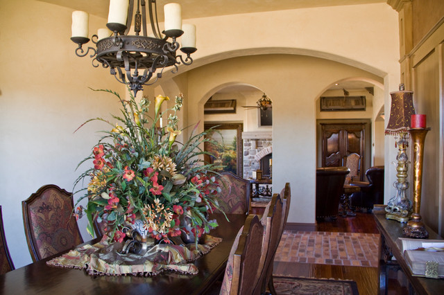 Example of a mid-sized tuscan dark wood floor kitchen/dining room combo design in Austin with beige walls