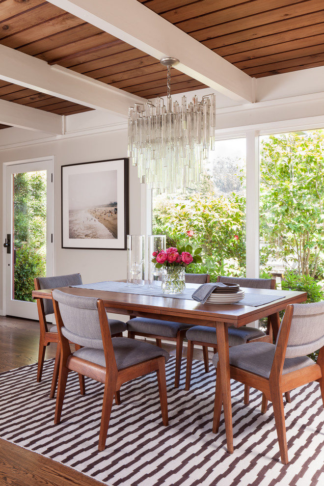 Example of a large mid-century modern dark wood floor great room design in San Francisco with white walls