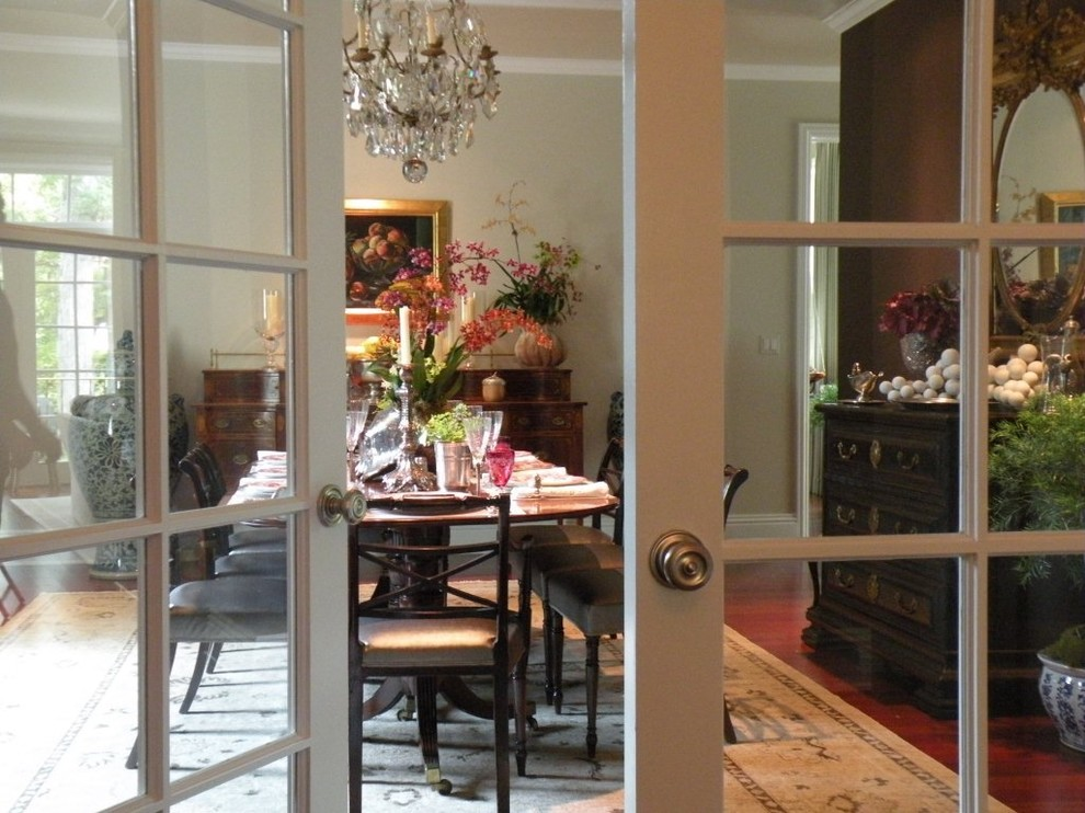 Large elegant dark wood floor and brown floor enclosed dining room photo in Chicago with beige walls and no fireplace