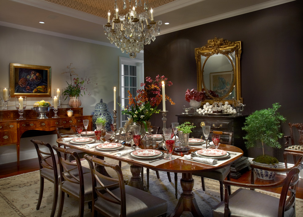 Example of a large classic dark wood floor and brown floor enclosed dining room design in Chicago with beige walls and no fireplace