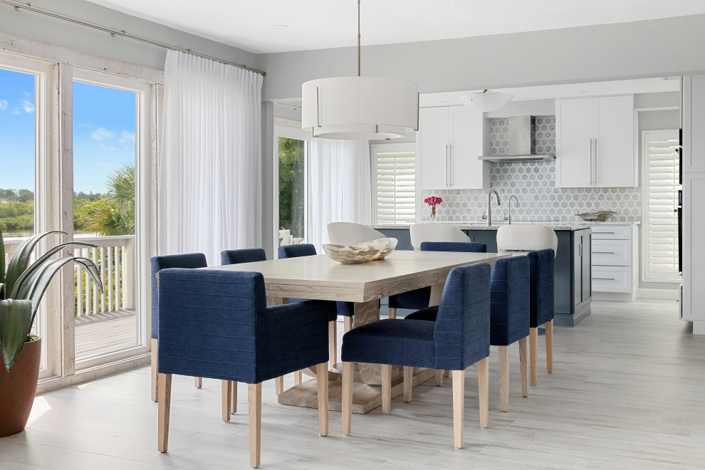 Inspiration for a transitional light wood floor and beige floor great room remodel in Tampa with gray walls and no fireplace