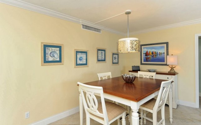 Siesta Key Waterfront Condo beach-style-dining-room