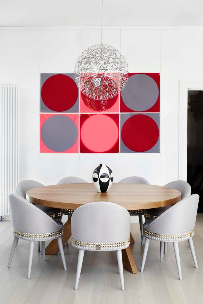 Example of a trendy light wood floor dining room design in Melbourne with white walls