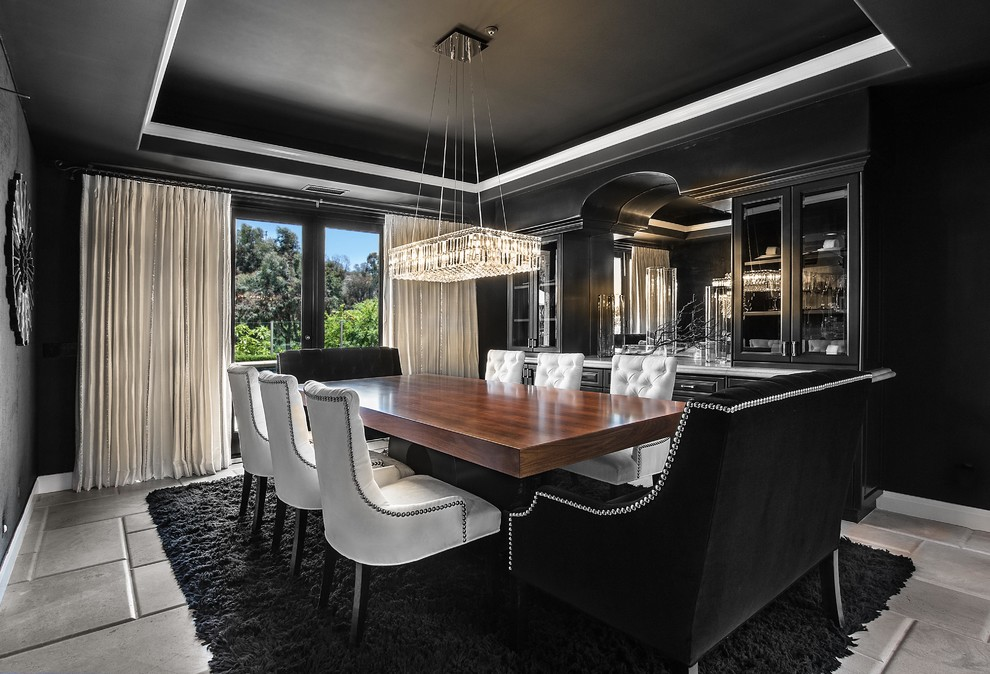 Dining room - contemporary dining room idea in Orange County with black walls