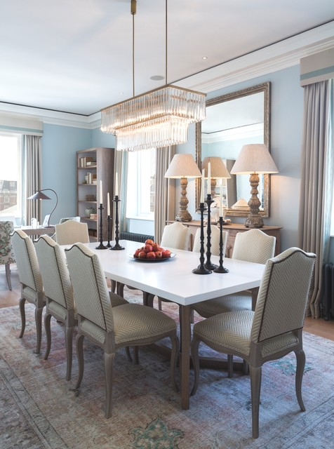 Elegant dining room photo in London with blue walls