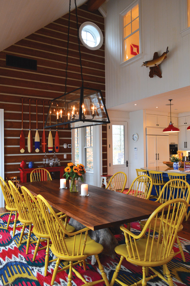 Example of a mountain style kitchen/dining room combo design in Toronto with white walls
