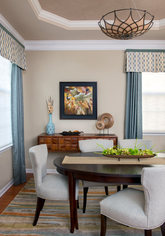Enclosed dining room - small traditional medium tone wood floor enclosed dining room idea in Newark with beige walls and no fireplace
