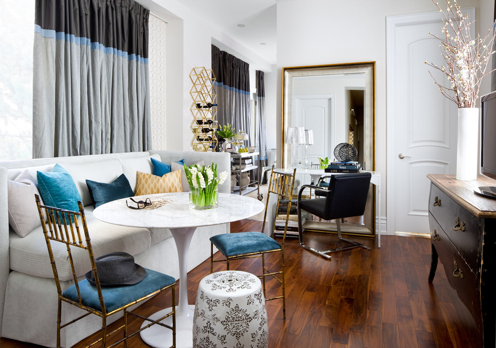 Example of an eclectic dark wood floor dining room design in Toronto with white walls