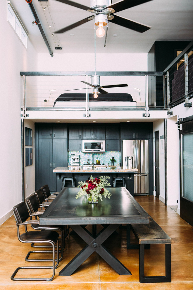 Large urban concrete floor kitchen/dining room combo photo in Los Angeles with white walls and no fireplace