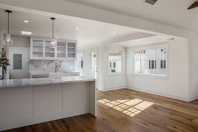 Inspiration for a modern medium tone wood floor dining room remodel in San Francisco with white walls