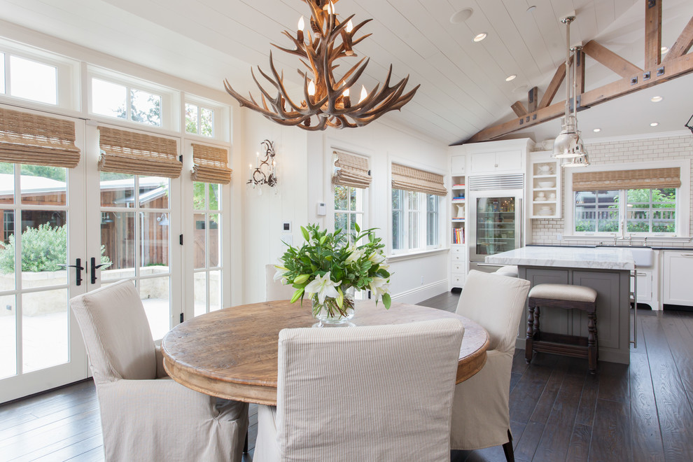 Inspiration for a country dark wood floor kitchen/dining room combo remodel in San Francisco with white walls and no fireplace