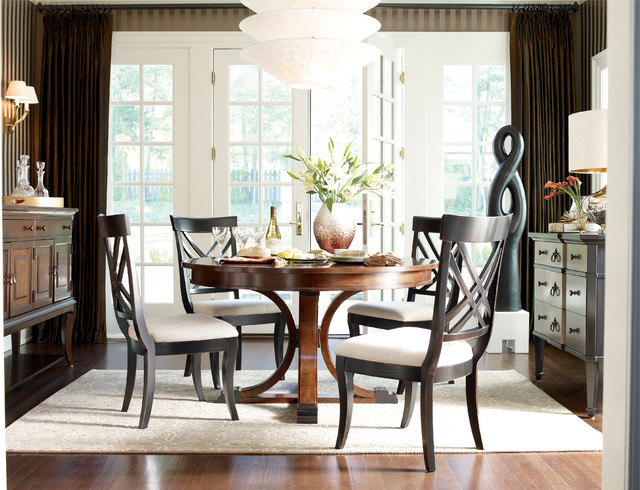 sophisticated dining room with round table - traditional - dining