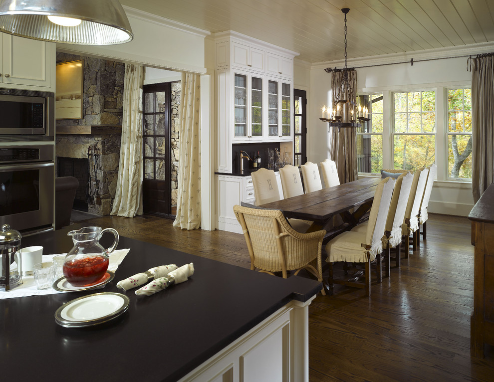 Kitchen/dining room combo - traditional dark wood floor kitchen/dining room combo idea in Atlanta with white walls