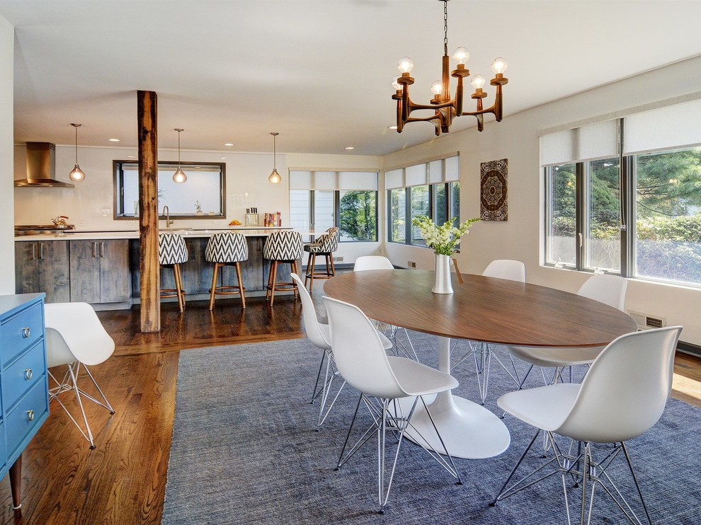 Trendy dark wood floor kitchen/dining room combo photo in Newark with white walls and no fireplace