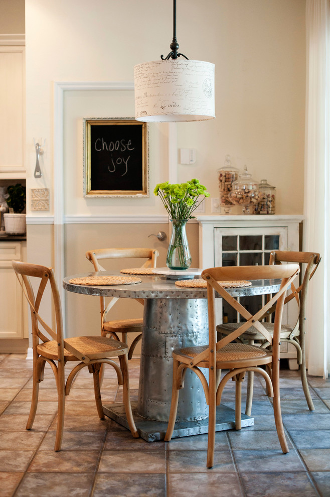 Inspiration for a transitional dining room remodel in Tampa with white walls