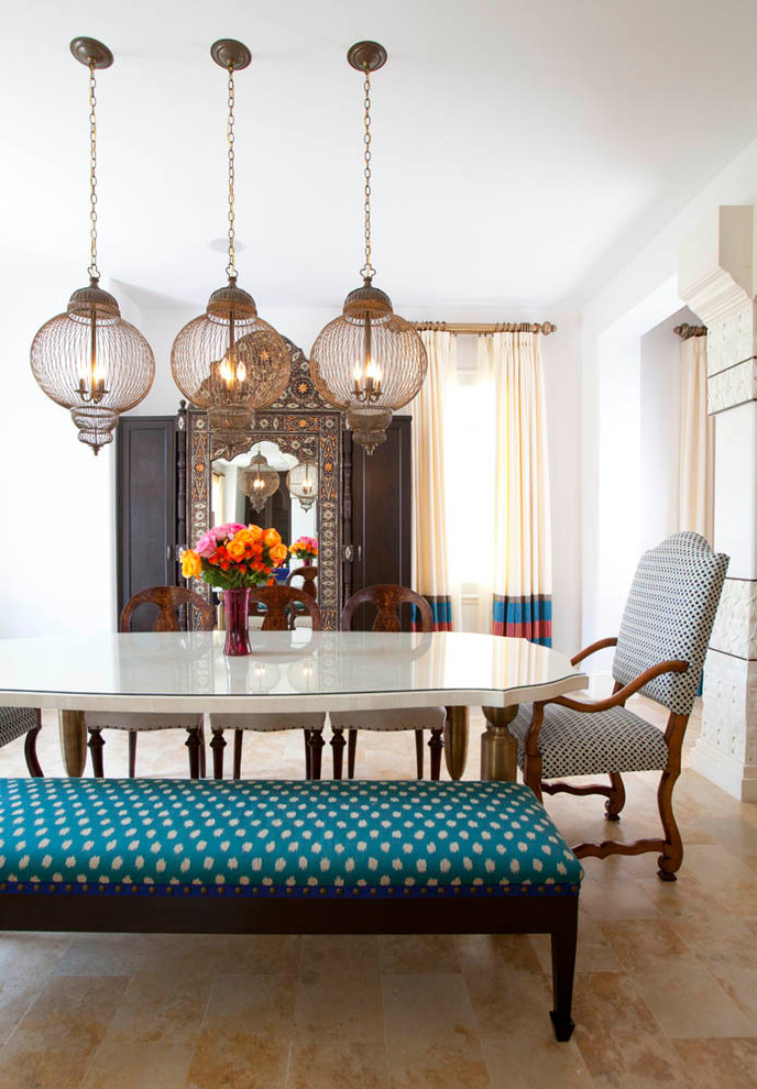 Dining room - mediterranean dining room idea in Houston with white walls