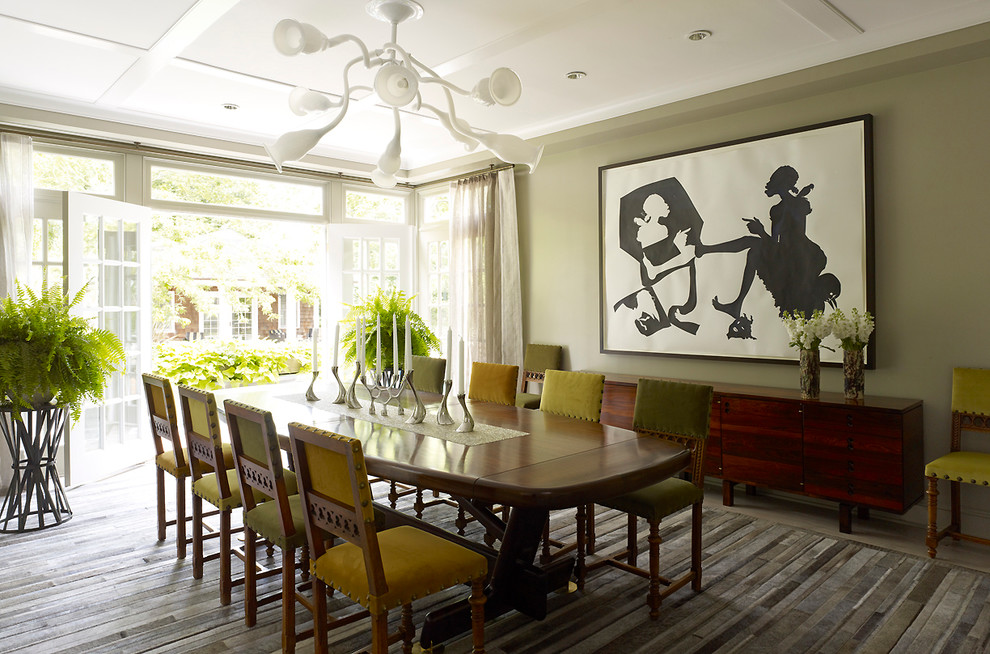 Example of a mid-sized 1950s enclosed dining room design in New York with green walls