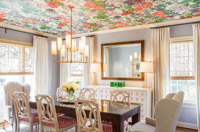Example of a classic dining room design in Houston with gray walls