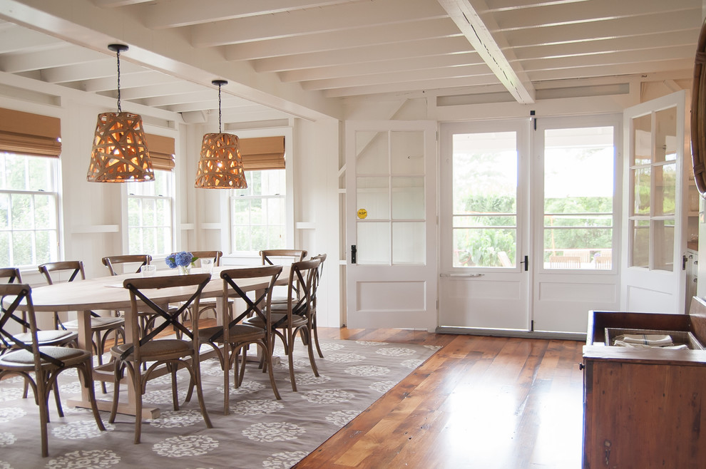 Large beach style medium tone wood floor enclosed dining room photo in Bridgeport with white walls and no fireplace