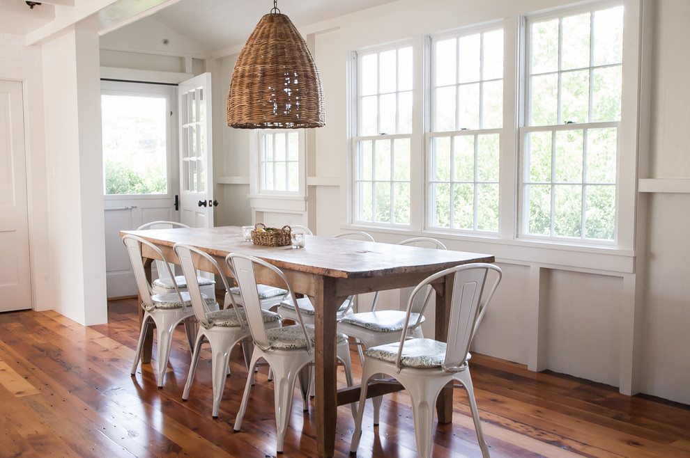 Dining room - mid-sized coastal medium tone wood floor dining room idea in Other with white walls