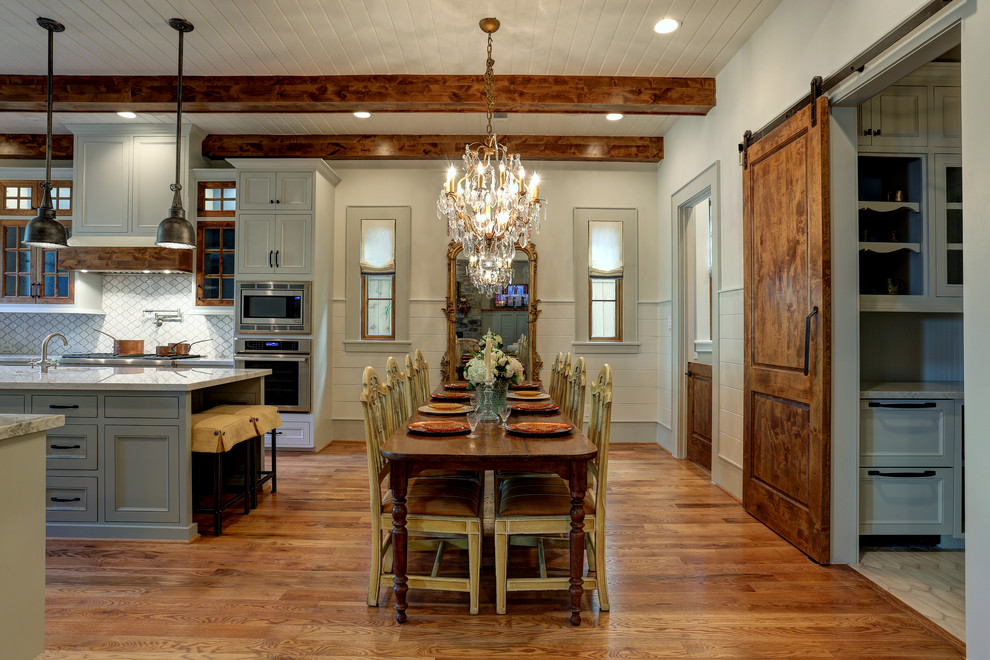 Example of a classic medium tone wood floor and brown floor great room design in Houston with beige walls