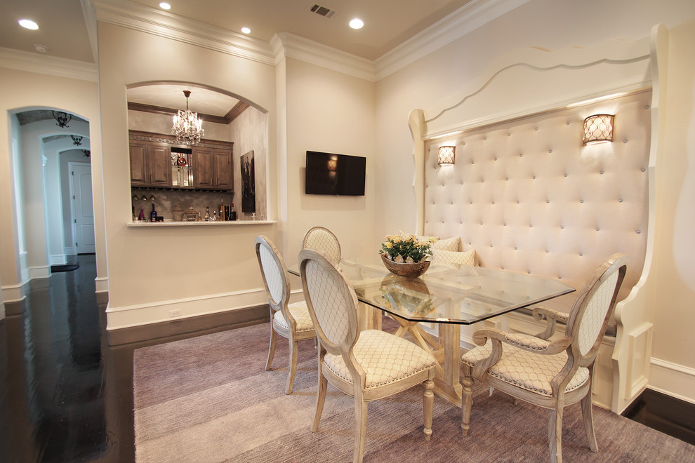 Inspiration for a large timeless dark wood floor dining room remodel in Dallas with beige walls