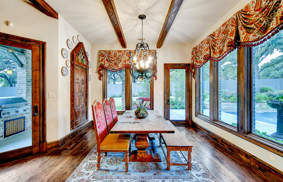 Enclosed dining room - large traditional dark wood floor enclosed dining room idea in Dallas with beige walls and no fireplace