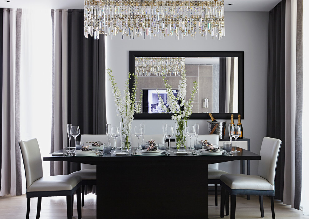 Dining room - transitional light wood floor dining room idea in London with gray walls and no fireplace