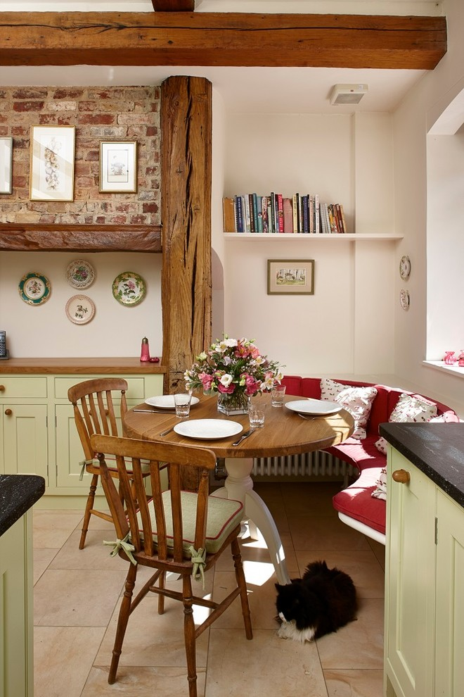 Kitchen/dining room combo - small country limestone floor kitchen/dining room combo idea in Surrey with beige walls