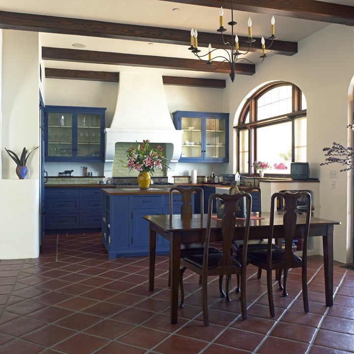 Tuscan brown floor dining room photo in Los Angeles