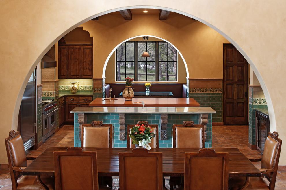 Kitchen/dining room combo - mediterranean terra-cotta tile kitchen/dining room combo idea in Austin