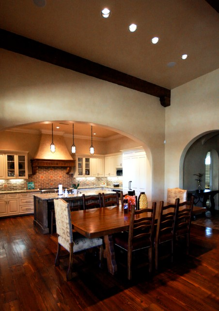 Inspiration for a mid-sized timeless kitchen/dining room combo remodel in Dallas with yellow walls