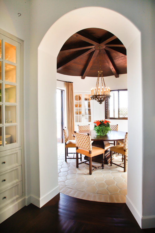 Mid-sized tuscan concrete floor and multicolored floor kitchen/dining room combo photo in Los Angeles