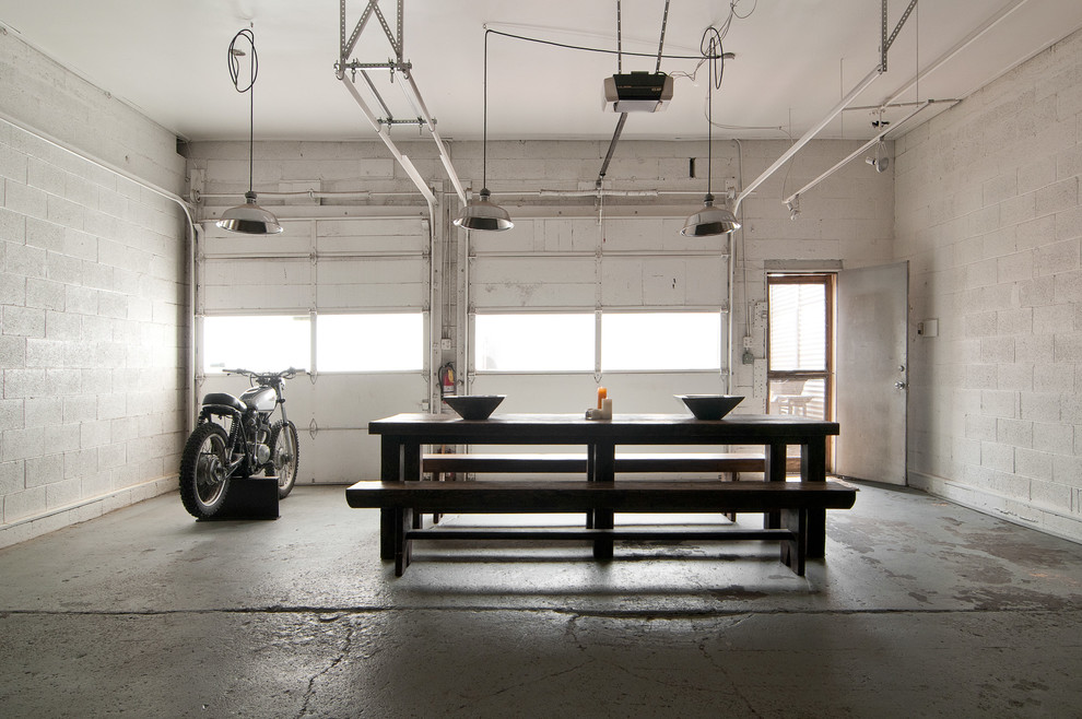 Inspiration for an industrial dining room remodel in Salt Lake City with white walls