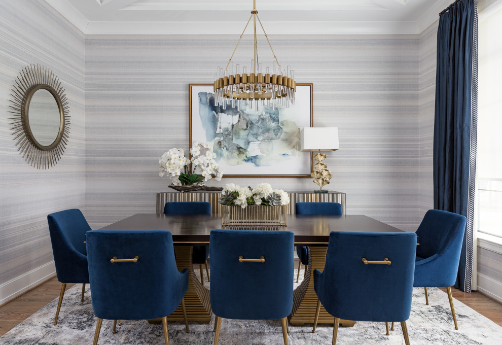 Inspiration for a transitional medium tone wood floor, brown floor, tray ceiling and wallpaper dining room remodel in Houston with multicolored walls