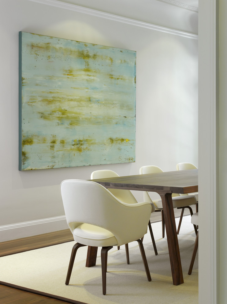 Inspiration for a contemporary medium tone wood floor dining room remodel in San Francisco with white walls