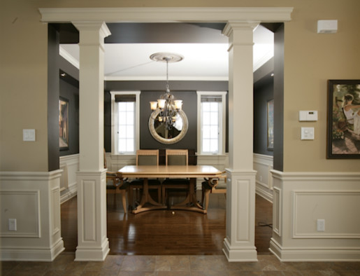 Example of a mid-sized transitional medium tone wood floor enclosed dining room design in Toronto with gray walls and no fireplace