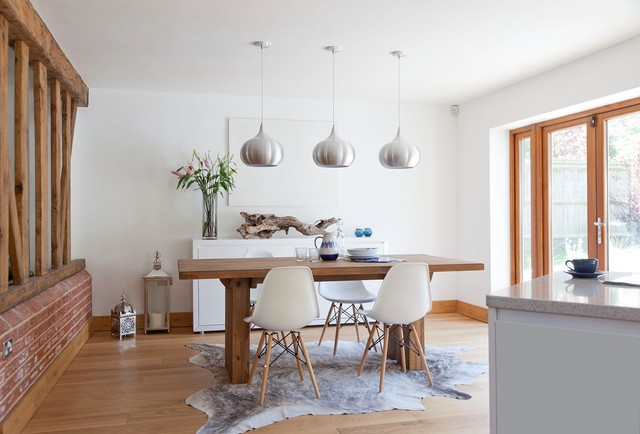 This is an example of a contemporary dining room in Kent.