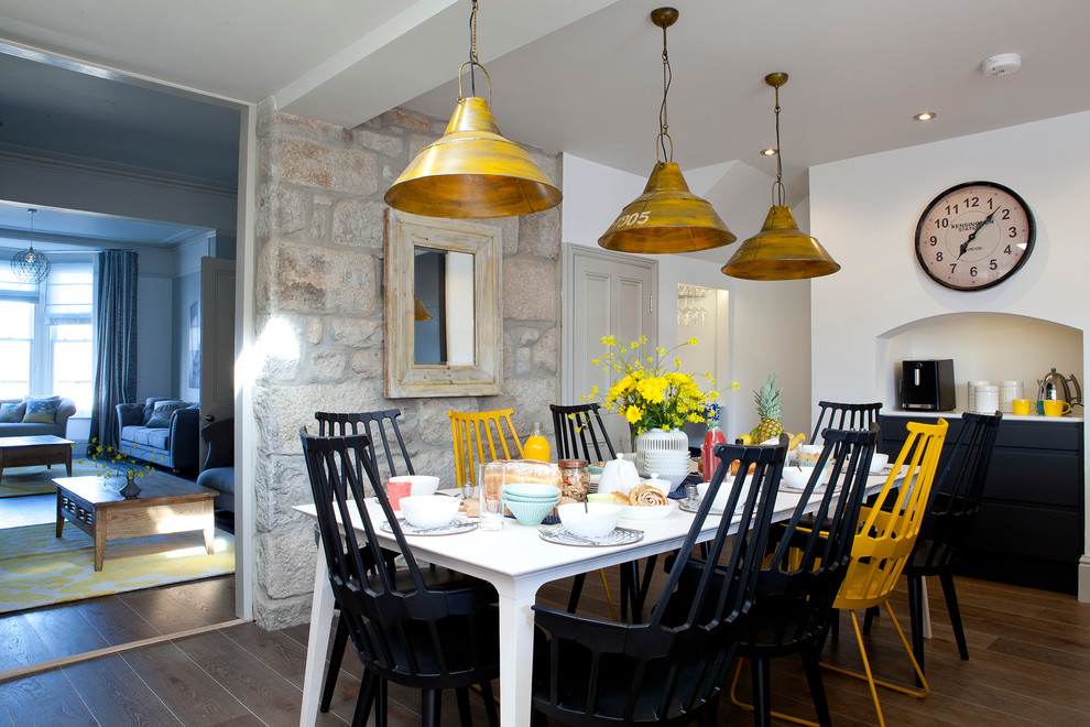 Inspiration for a coastal dark wood floor dining room remodel in Cornwall with white walls