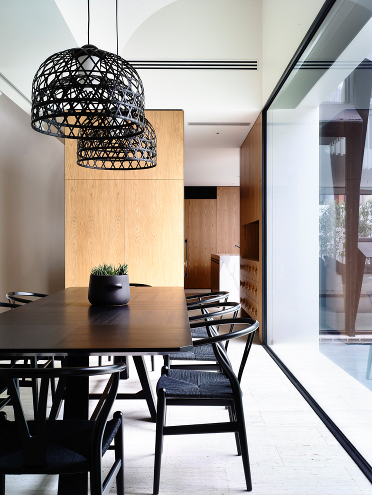 Example of a trendy dining room design in Melbourne