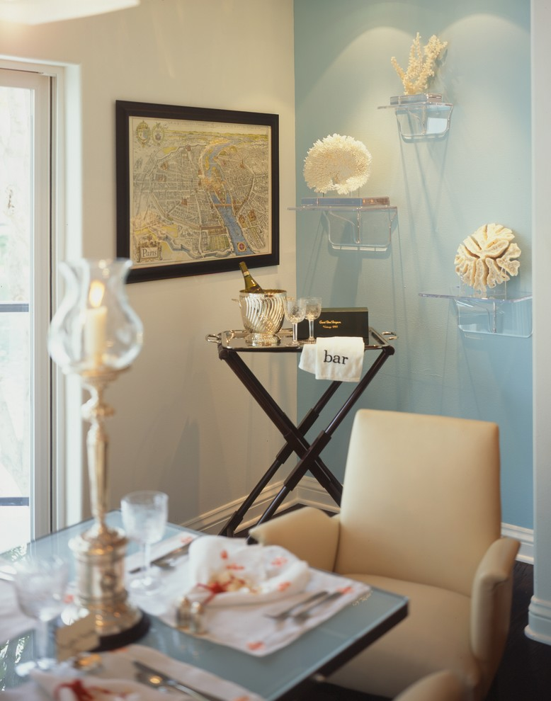 Inspiration for a coastal dining room remodel in Los Angeles with blue walls