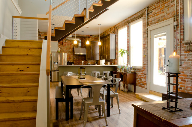 Industrial Medium Tone Wood Floor Kitchen/dining Room Combo Idea