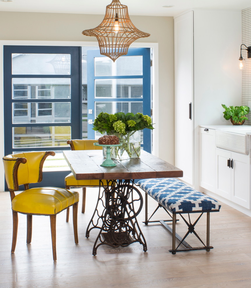 Inspiration for a contemporary light wood floor dining room remodel in Other