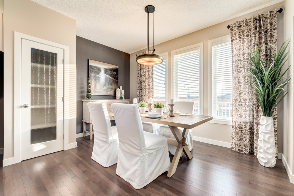 Inspiration for a contemporary dark wood floor dining room remodel in Calgary with gray walls