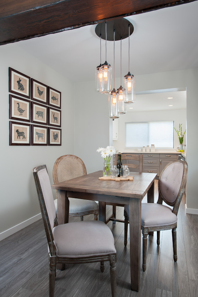 Example of a small classic dining room design in Vancouver with gray walls