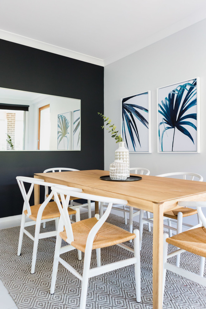 Inspiration for a coastal ceramic tile and white floor enclosed dining room remodel in Sydney with black walls