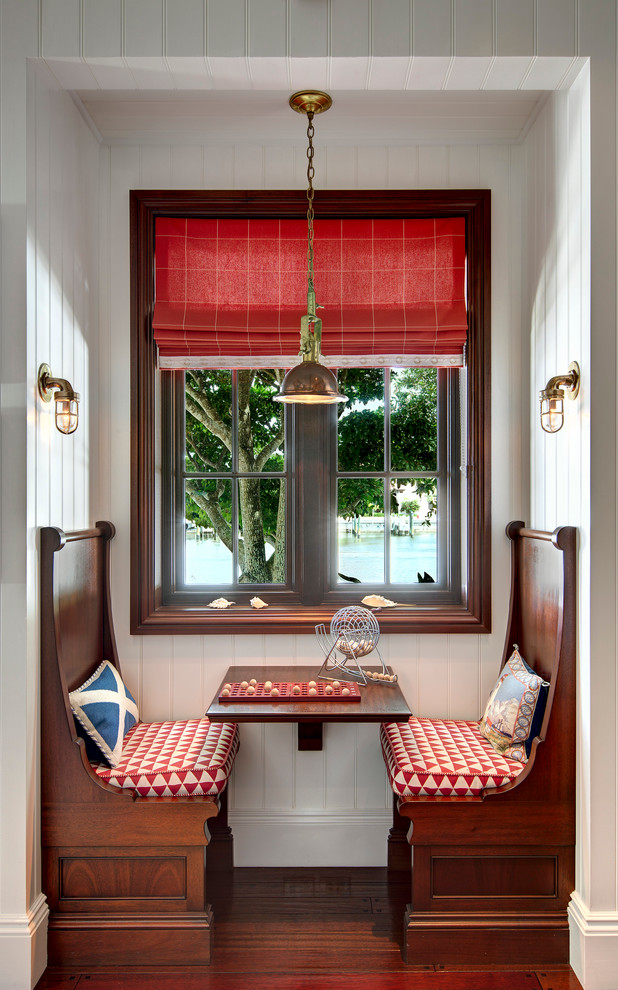 Example of a small beach style dark wood floor kitchen/dining room combo design in Miami with white walls